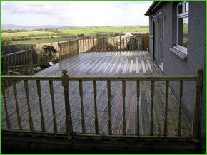 classic decking, with a wooden railing and waterproof coating