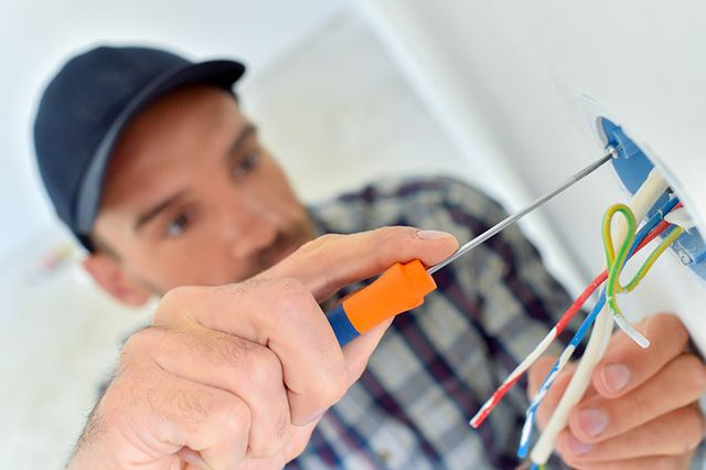 Electrician fixing light switch