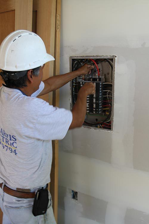 Electrical contractor connecting the wires in the newly constructed house in Kailua-Kona, HI