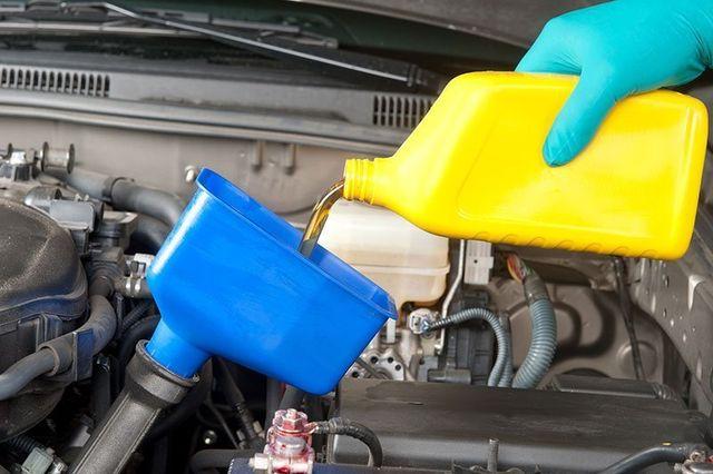 Mechanic changing engine oil