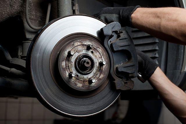 Mechanic repairing brake pads