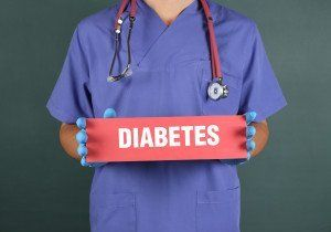 nurse holding a diabetes sign