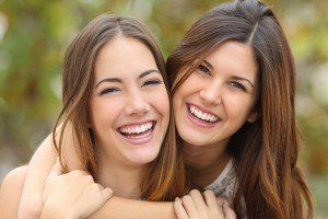 two women with big smiles