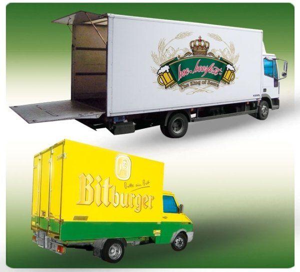 due camion uno bianco con il logo Boc Beerfest e uno giallo con il logo Bitburger