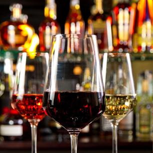 A glass of rose, a glass of red and a glass of white wine