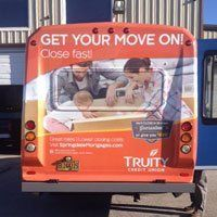 truity credit union tail bus wrap