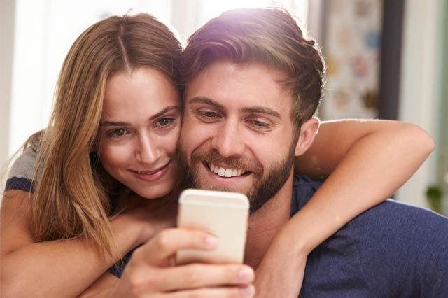 young couple looking at smart phone