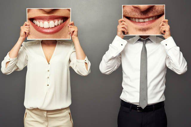 man and woman with zoomed pics of smiles