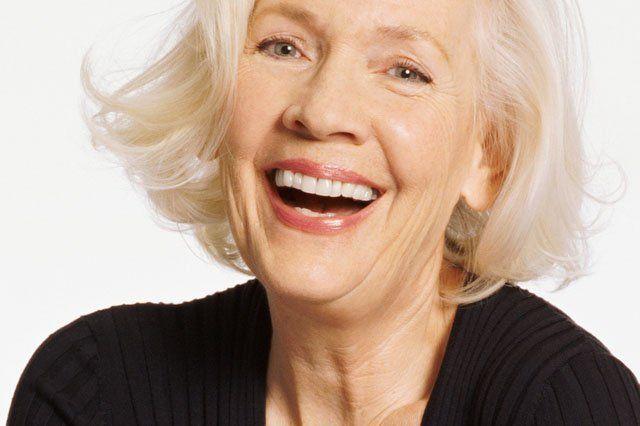 happy mature woman in black top