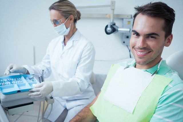 smiling young male patient wait for dental treatment