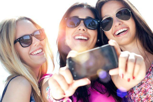 three young woman taking selfie
