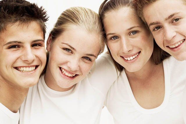 young smiling teens dressed in white