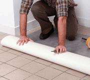 unrolling vinyl floor covering