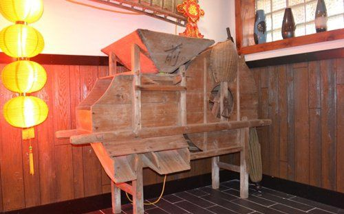 Antique grain mill at Chinese restaurant in Tomah, MO
