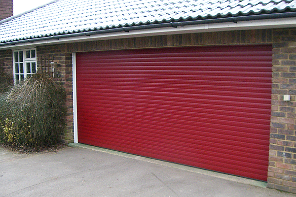 red garage door & We install electric roller shutters in and around Telford