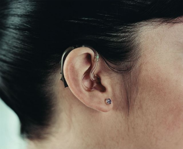 woman with a hearing aid after hearing assessment in Cincinnati, OH