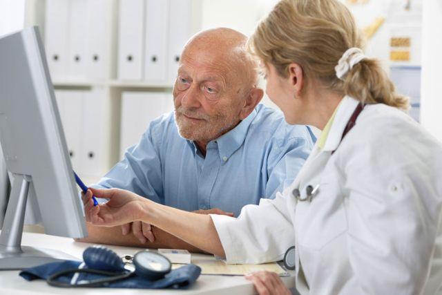 audiologist performing hearing assessment for man in Cincinnati, OH