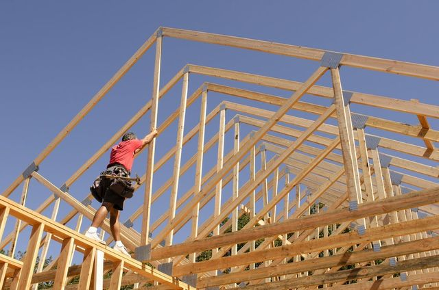man building a roof in West Salem, WI