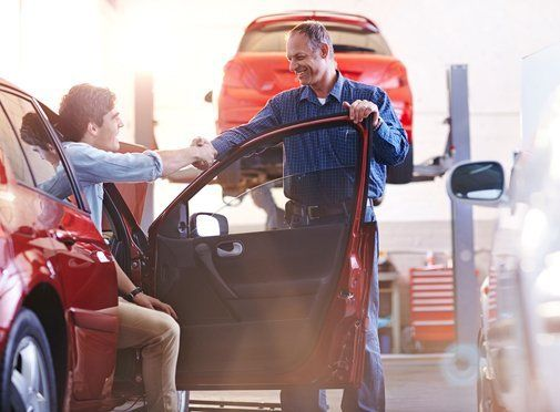customer shaking hands with the mechanic