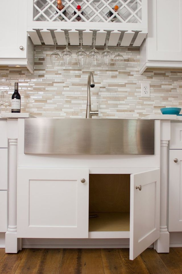 Image Of A White Kitchen Cabinet Under A Stainless Steel Sink