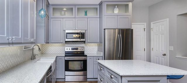 Image Of A White Kitchen Featuring Pearl Gray Cabinets