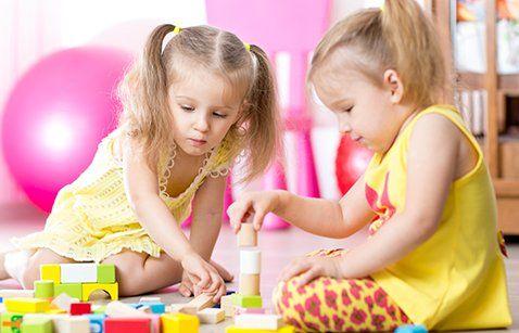 Children playing wooden toys at kindergarten