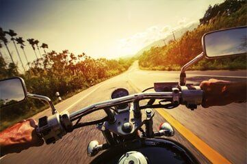Motorcycle Insurance — Riding Motorcycle in Denver, CO