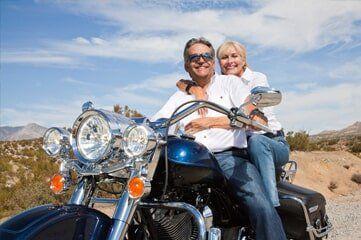 ATV Insurance — Couple Riding Motorcycle in Denver, CO