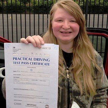 girl with a driving lessons certificate