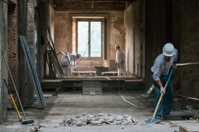 Construction workers in site before construction cleaning services