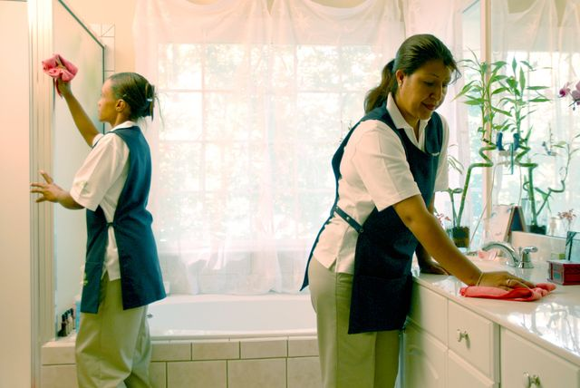 Maids providing home cleaning services