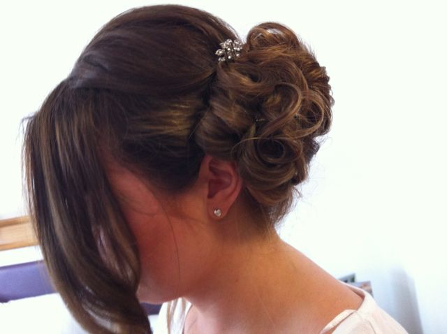 An updo with long piece left loose at the front, and hair at the back held with a diamante clip