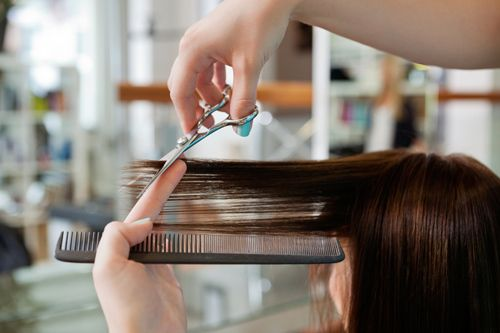 Girl enjoying a fantastic haircut in Columbia, MO