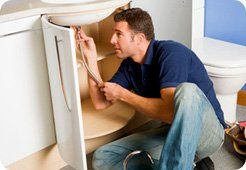 water leakage - Bristol, Swindon, Wales - ACW Maintenance Services - man fixing sink