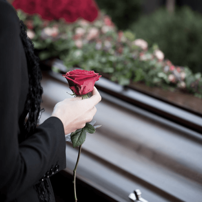 A person holding a rose