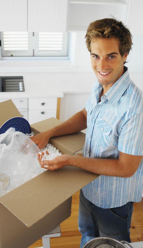 Man unpacking supplies in High Point, NC to put in storage bins