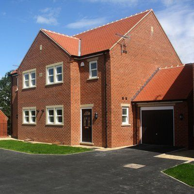 Building with tarmac driveway