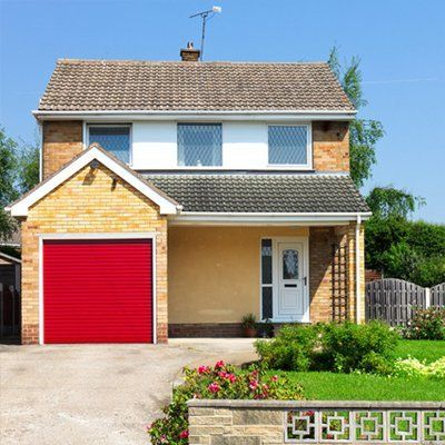 house with a red garage shutter