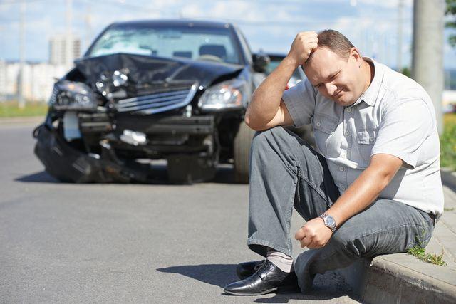 Upset person after car crash