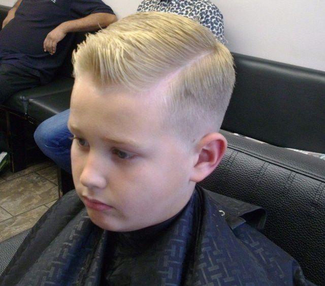 A gentleman getting his hair cut