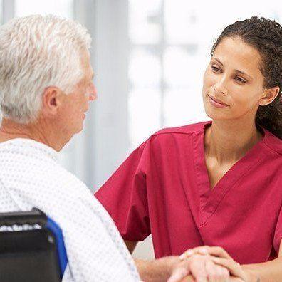 Aldersgate Village Assisted Living Nurse Helping Elderly Man