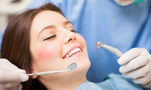 Woman taking a dental treatment