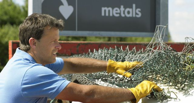 Man recycling metal in Wanganui
