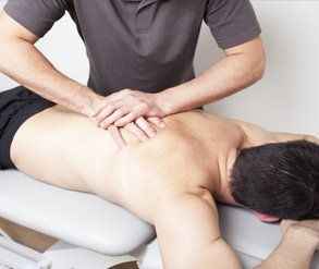 man having spinal manipulation