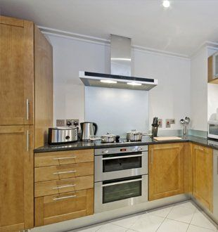 new kitchen with stainless steel overhead extractor and lighting unit