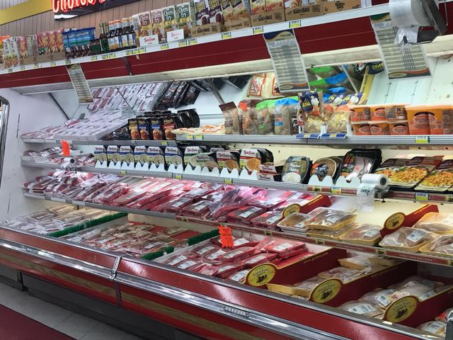 Buying fresh meats at our meat market in Elyria, OH