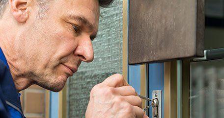 Locksmith unlocking the door
