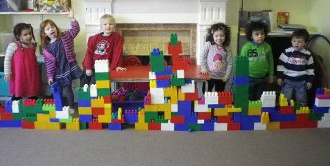 children posing with their blocks game