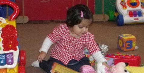 girl playing with toys