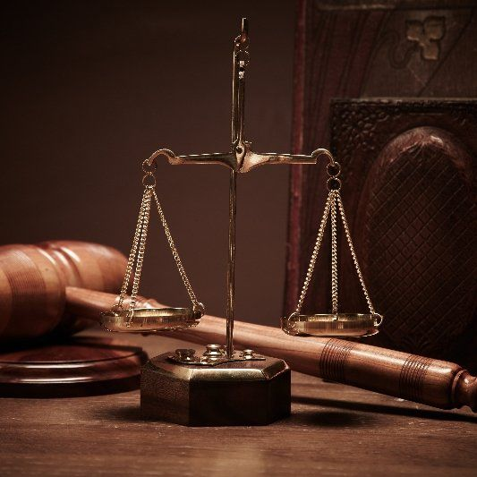 Gavel and scales of justice as symbols for attorney services